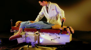 This is a picture of Cox Technic chiropratic spinal manipulation as performed at Wilson Family Chiropractic.
