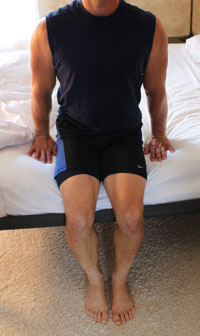 use hhands and legs to push up out of bed